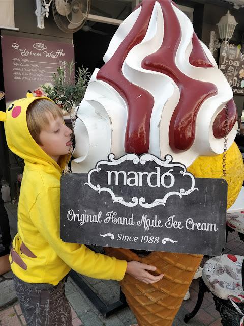 child with giant ice-cream model in Nicosia, Cyprus