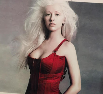 Christina Aguilera shares semi-nude throwback photos of herself...