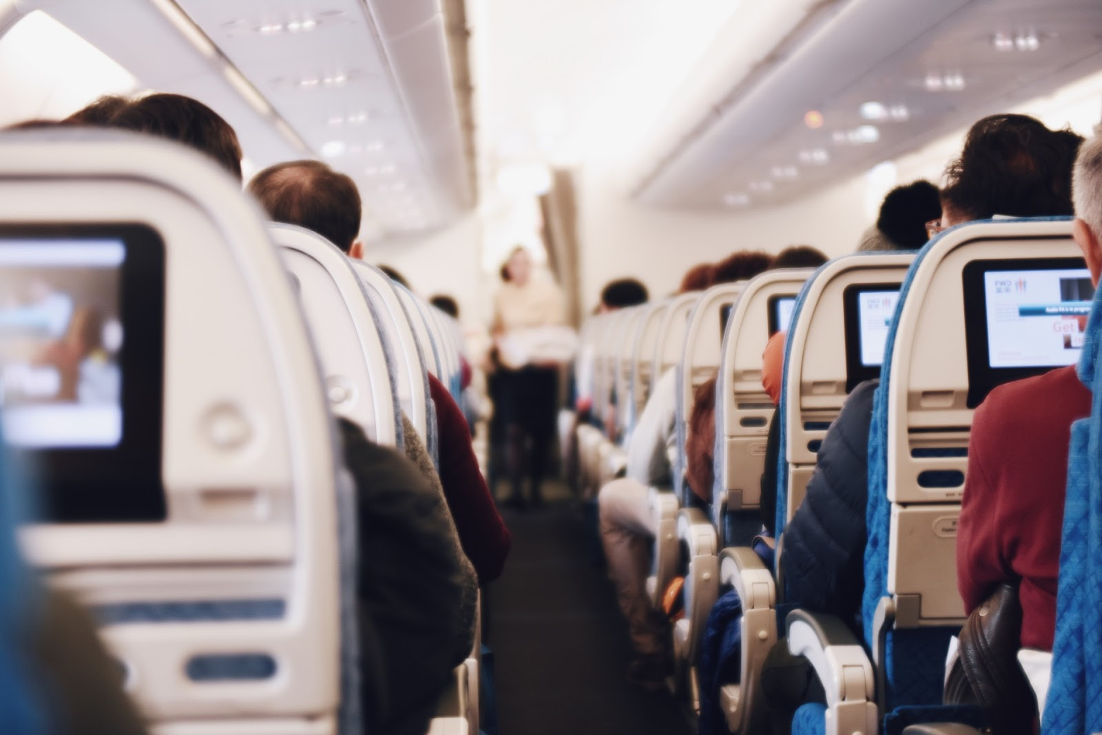 https://pixabay.com/en/indoor-airplane-airline-people-2594469/