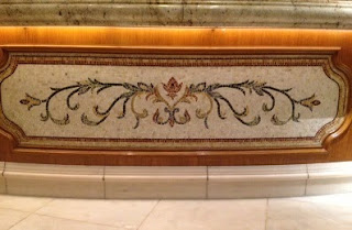 Elegant mosaics and marble tiles adorn the reception area of the Bellagio's lobby.