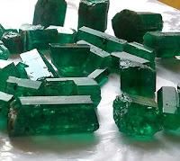 raw, uncut emeralds in crystal form