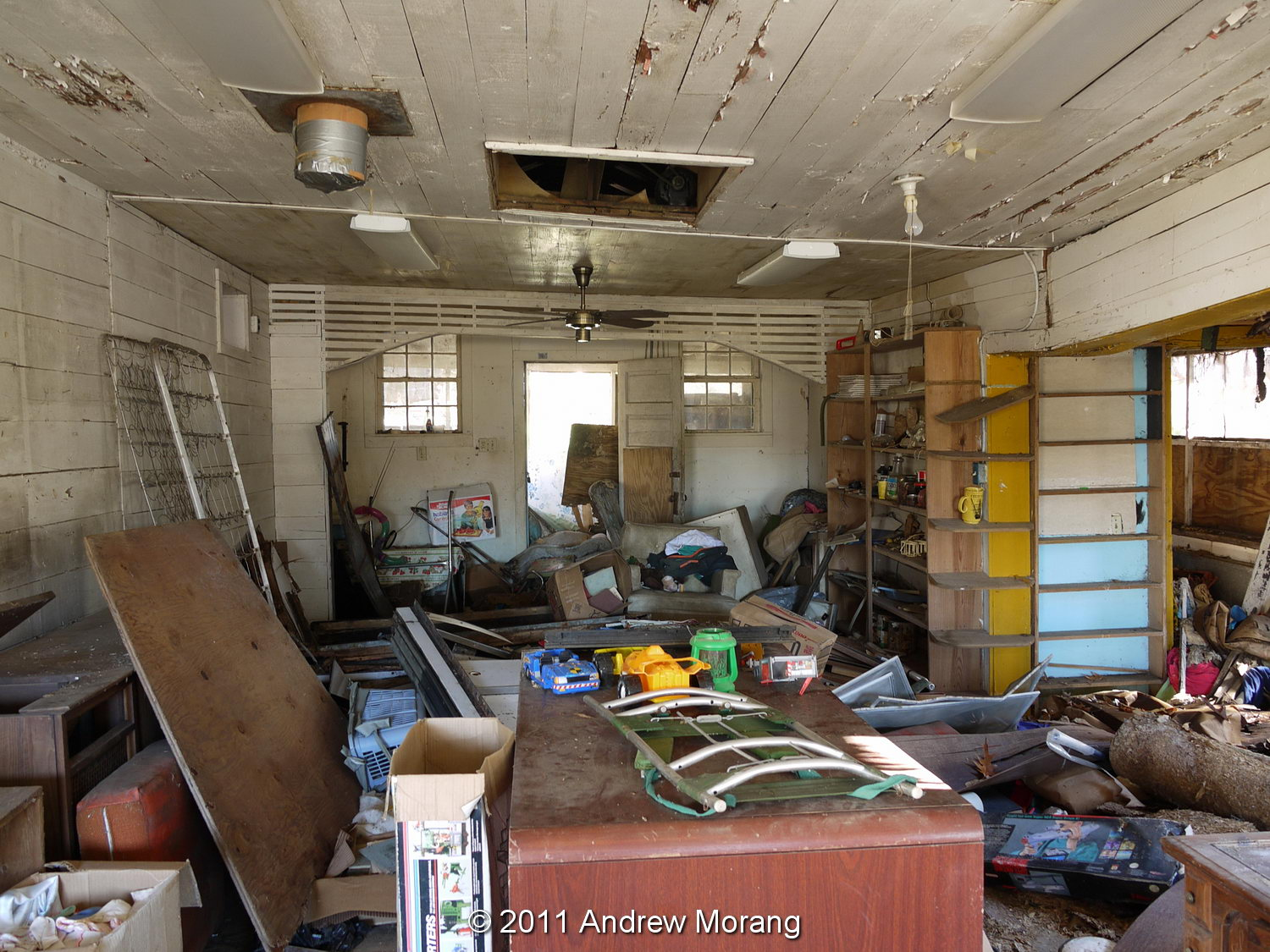 The Roof On The Main Building Is Still Intact, And It Looks Like The Owners  Have Been Storing Miscellaneous Junk For Awhile. Notice The Wood Boards  Forming ...
