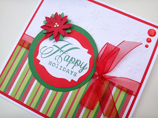 Handmade Christmas card with die cut poinsettia and stamped greeting