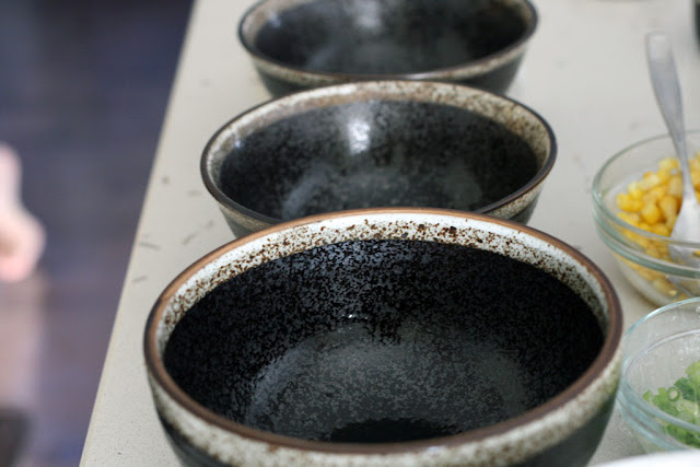 A picture of three empty ceramic bowls.