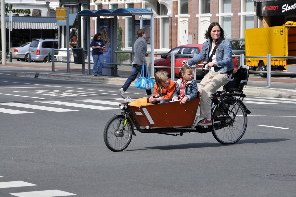 family-friendly Amsterdam - a mum and her kids on a cargo bike
