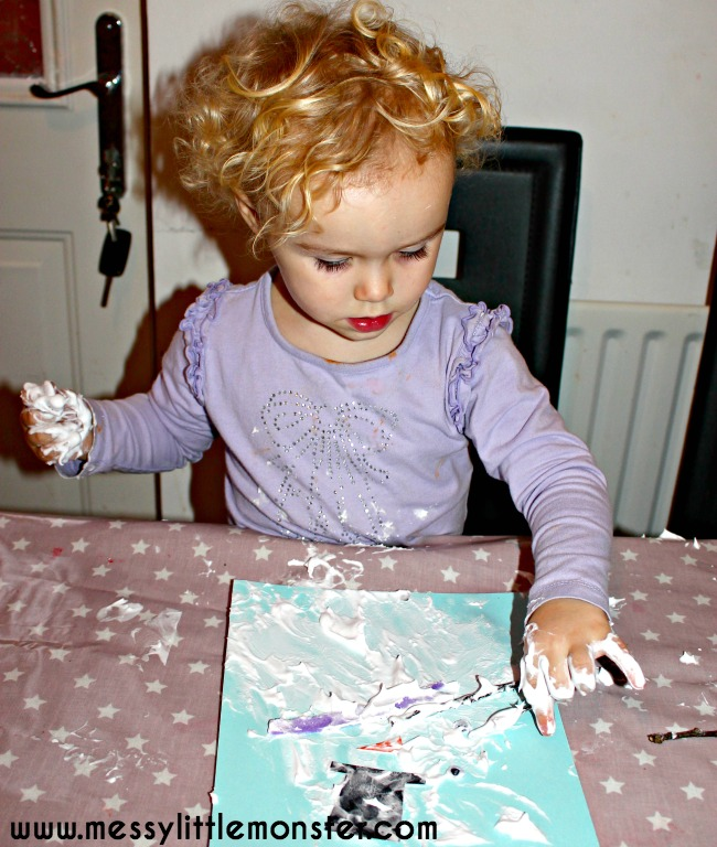 Puffy paint melted snowman preschooler craft. Winter themed activity idea.