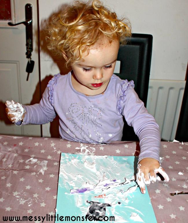 Puffy paint melted snowman preschooler craft. Winter themed activity idea.