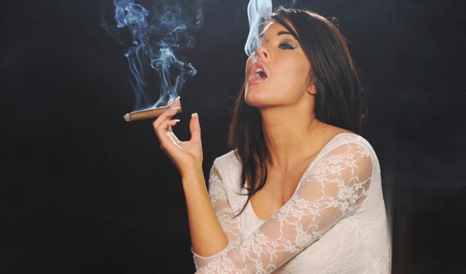Nude women smoking cigars