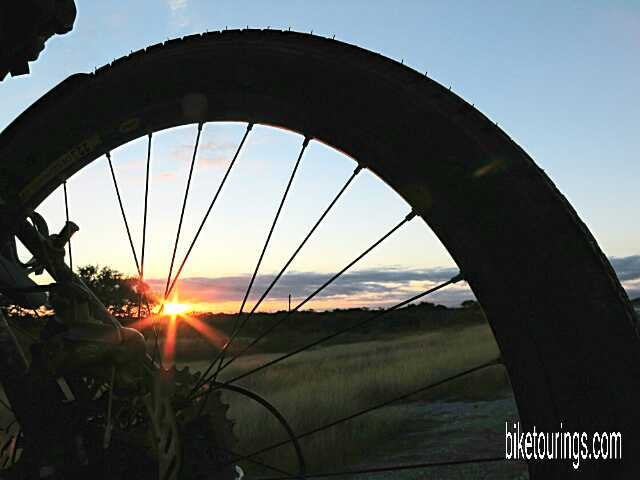 Picture of touring bike wheel with Texas Hill Country Sunrise