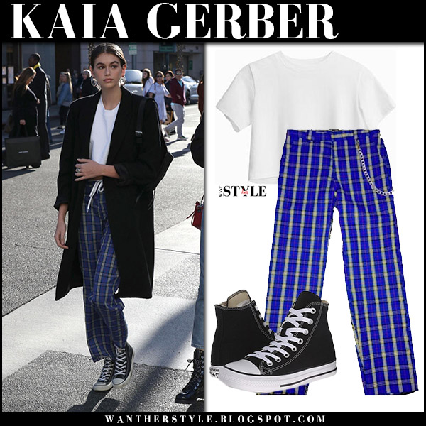 Kaia Gerber in black coat and blue plaid pants street style december 21