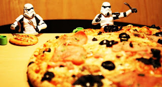 Star Wars Stormtroopers eating a pizza.