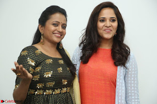 Actress Suma in Black Salwar Suit and Anusuya in orange Dress at winner movie press meet part 1 February 2017 (27).JPG