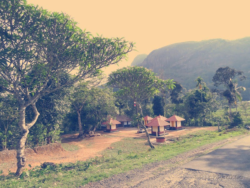 A serene temple at the foot of hill - Kerala country side