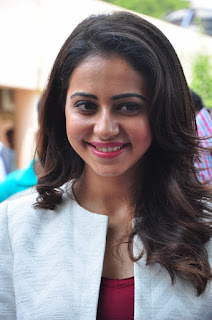 Actress Rakul Preet Singh Stills in Ripped Jeans at Traffic Awareness  0013.jpg