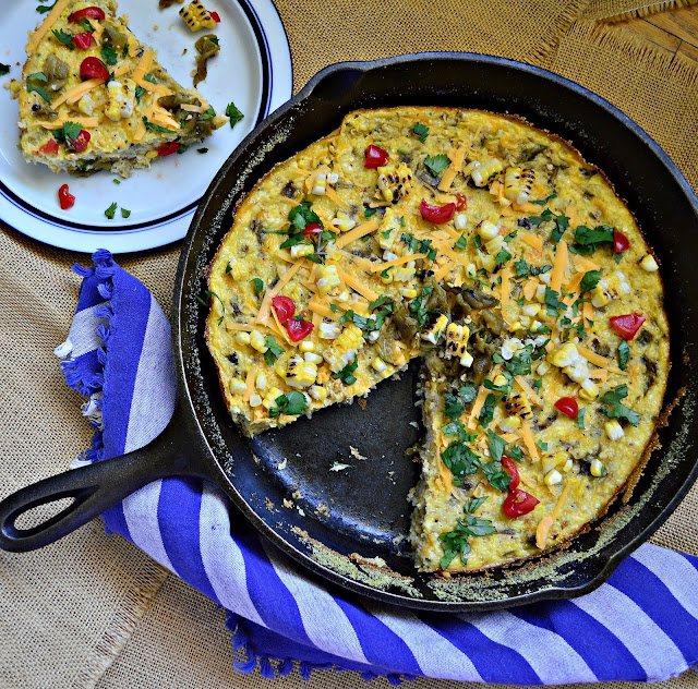 Corn and Grits Puddin' with green chilies and cheese is easy to make and better to eat. Love this skillet dish as a main course or a side dish! #corn #skilletrecipe #greenchiles #cornbread www.thisishowicook.com