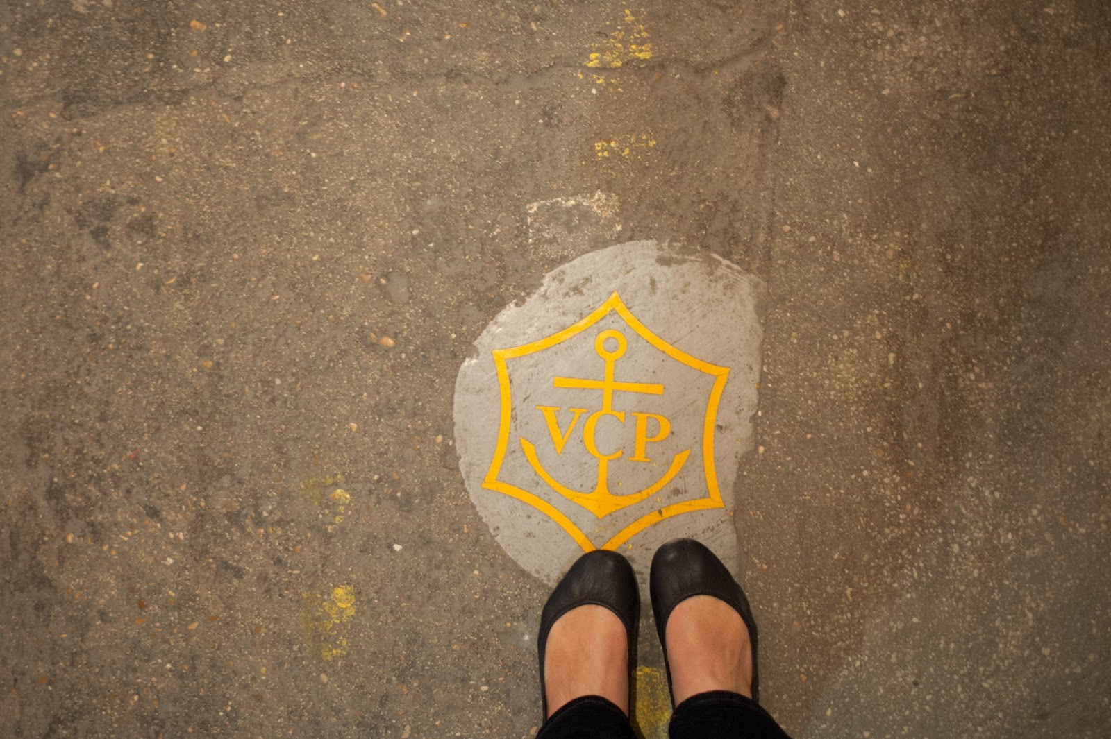 Crest embedded in the ground at Veuve Cliquot Champagne Outside Paris in Reims