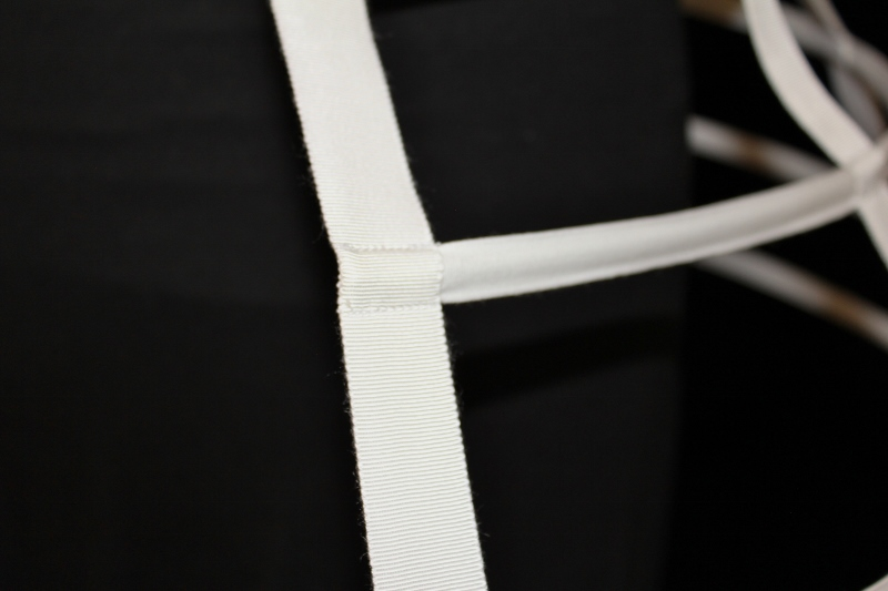 23ccb55483 The front ribbons have a slot sewn into them for the steel and the very  front edge is sewn closed with hand stitching so that the hoop can t  protrude beyond ...