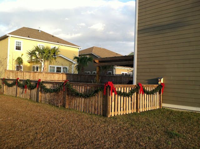 Modern traditional Southern Christmas decorations simple fence garland with red ribbon | The Lowcountry Lady