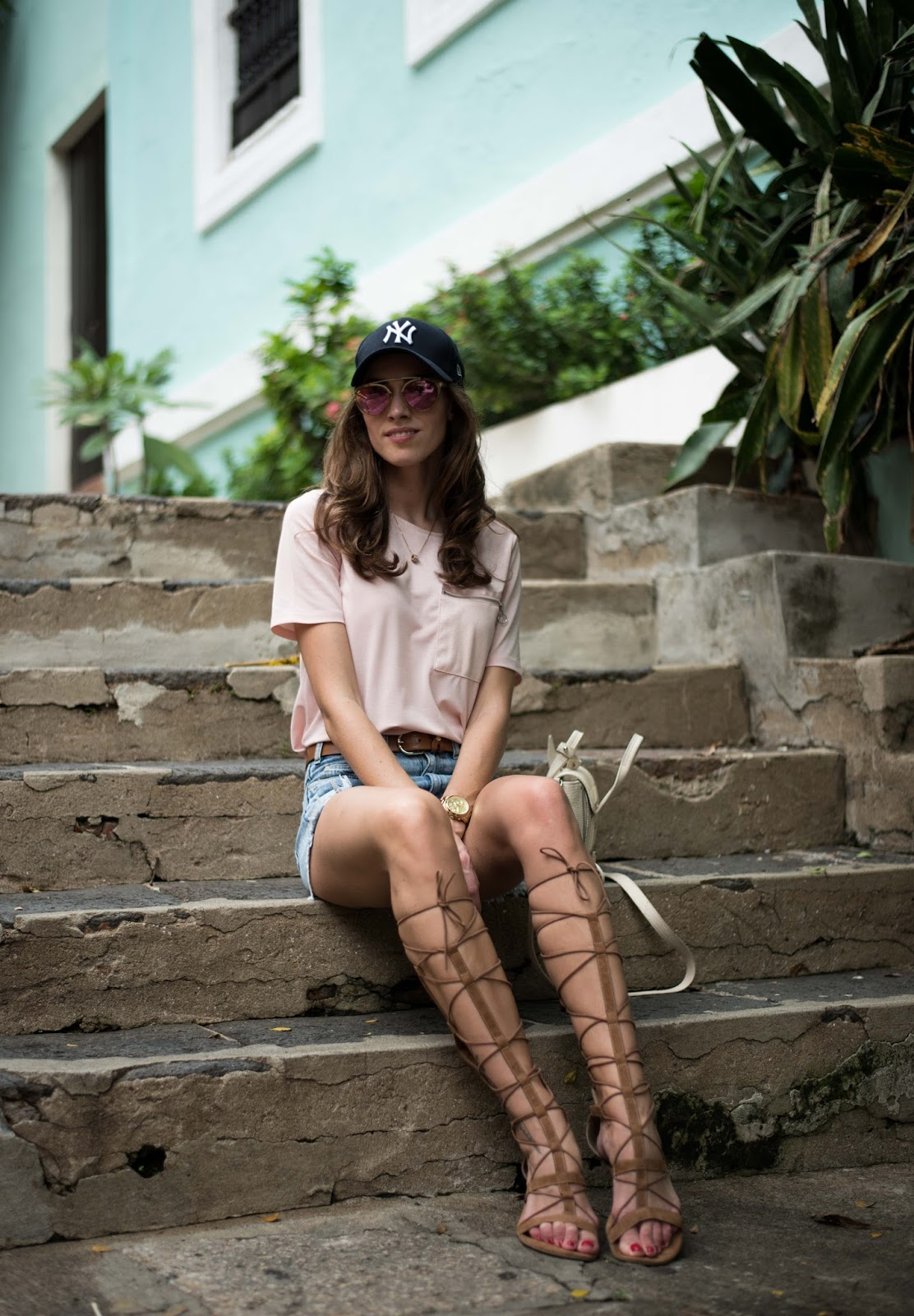 pink shirt gladiator sandals outfit