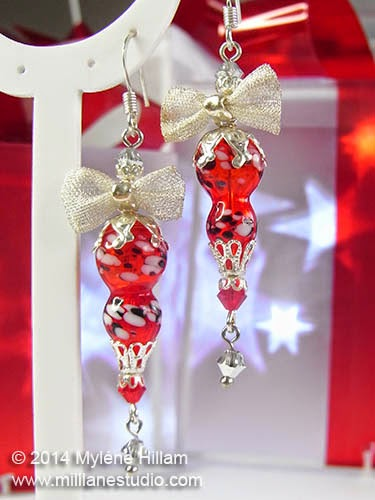Bright red and silver Christmas ornament earrings.
