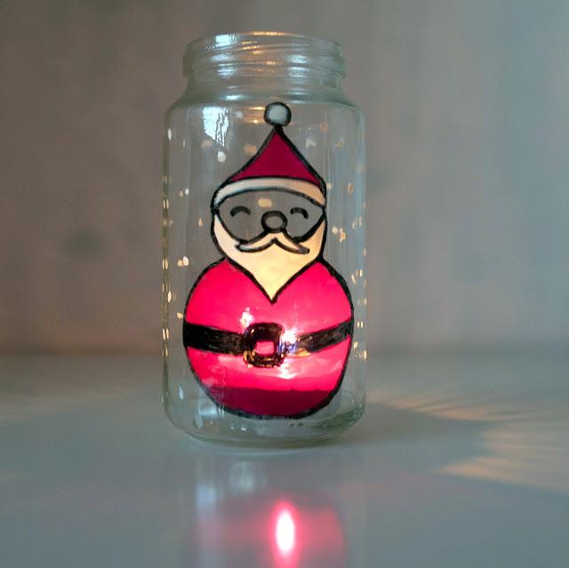 Portavelas de Papá Noel con vela encendida