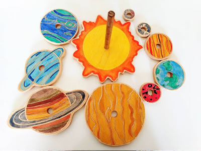 wooden planet stacking toy from Mirus Toys