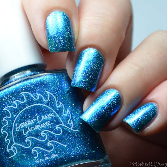 sapphire blue nail polish with holographic flecks