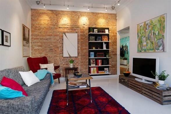 Decoração de sala de estar com parede de tijolinho a vista