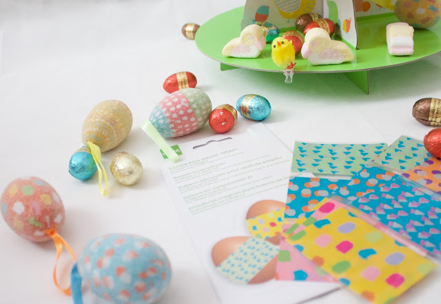 pretty pastel Easter decorations including patterned egg decals, patterned egg decorations, clip on chicks, easter duck marshmallows and chocolate eggs