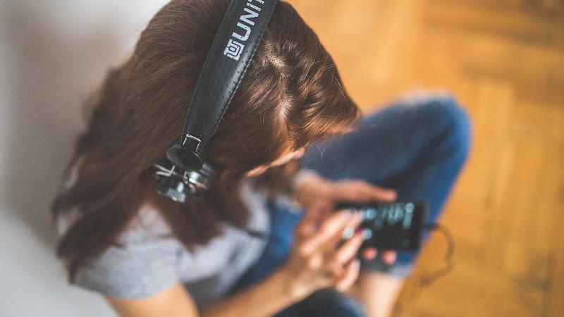 Girl Listen Music in Headphones HD