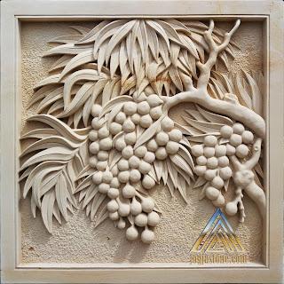 Relief batu alam paras putih atau batu paras jogja motif buah buahan