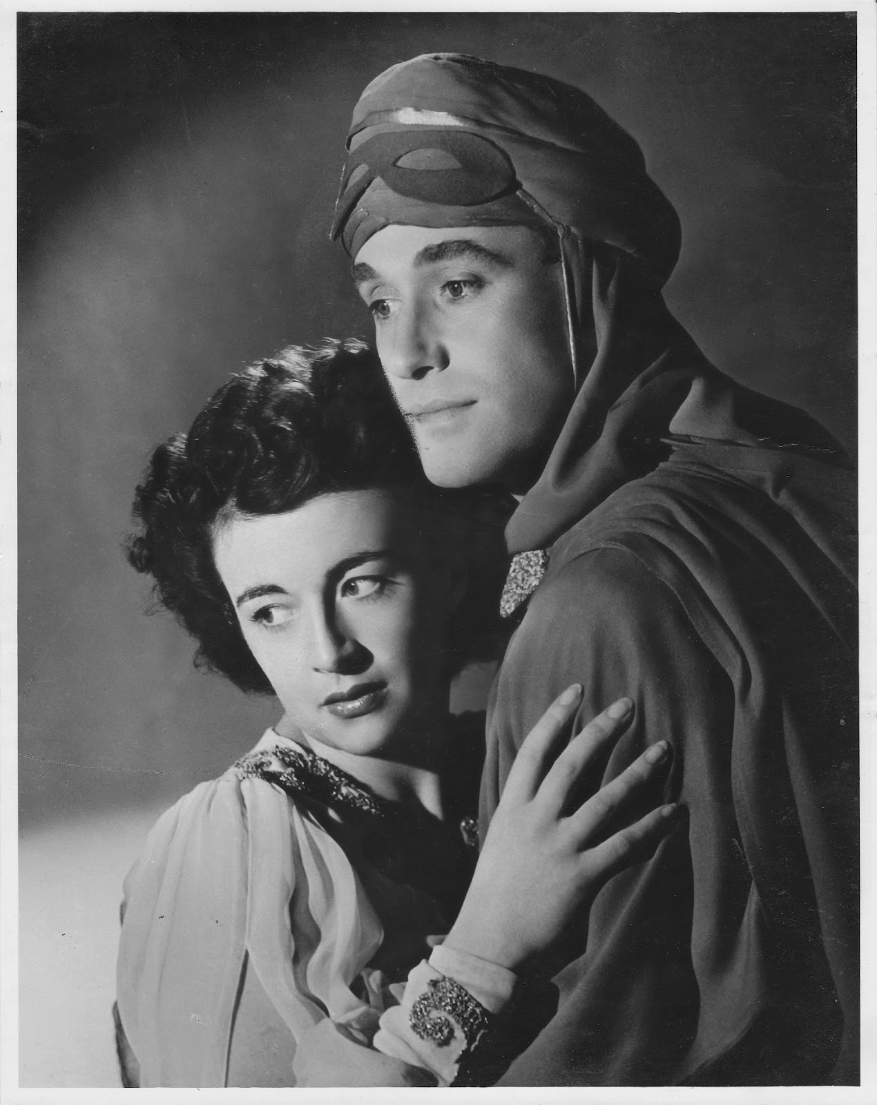 What a looker! Max Oldaker as The Red Shadow in The Desert Song with co-star Joy Beattie. 1945