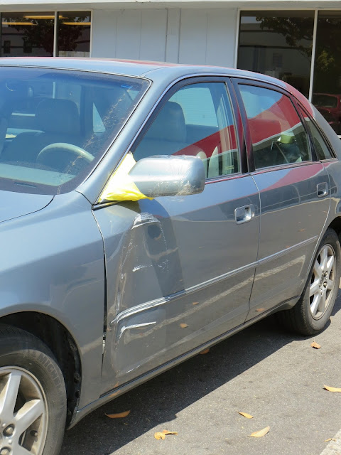 Damaged door, mirror and handle on 2001 Toyota Avalon at Almost Everything Auto Body