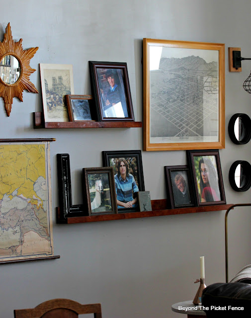 A gallery wall that is easy to change up with DIY picture ledges