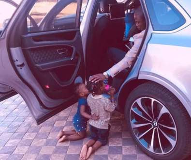 Wealthy Malawi pastor, Prophet Bushiri shares photo of his two young children kneeling before him