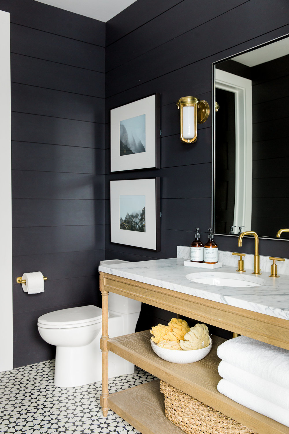 Shiplap painted black in bathroom with modern farmhouse style
