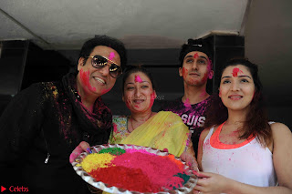 Govinda celeting Holi with His family wife daughter 006.JPG