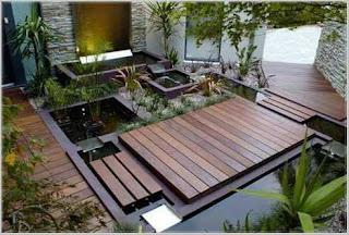 taman rumah minimalis dengan kolam ikan batu alam