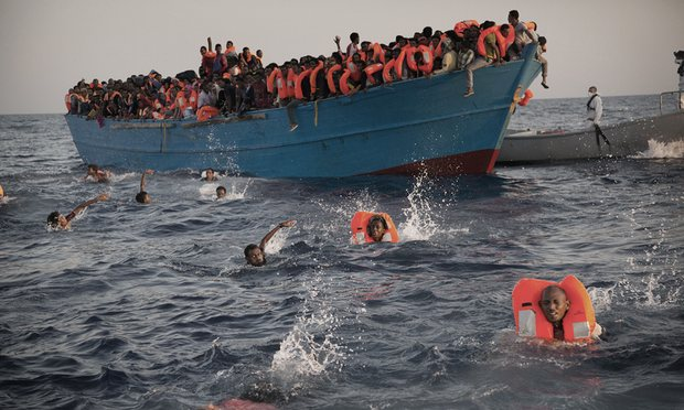 Dramatic photos show refugees fleeing Libya being rescued at sea