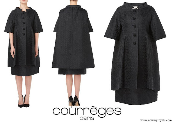 Meghan Markle wore Courreges Paris Haute Couture black trapeze coat