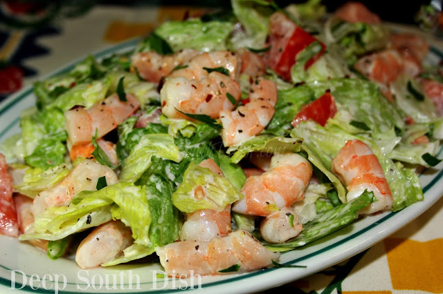 A very simple salad made with cooked shrimp, iceberg lettuce, fresh tomatoes and dressed with mayonnaise.