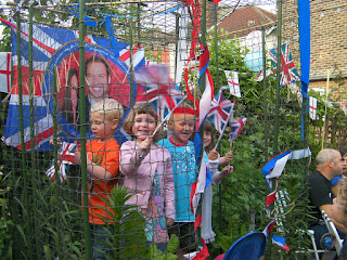 wave your patriotic flags kids in tomato cage
