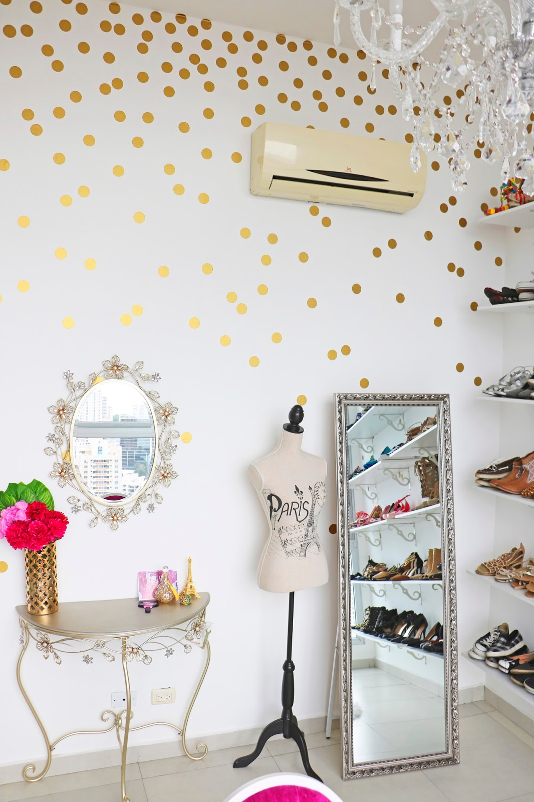 Use gold stickers to create this polka dot wall effect. Click through for more chic home decor ideas!