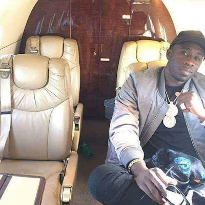 Photos of son of incoming President of Zimbabwe flaunting cash and luxury car on social media