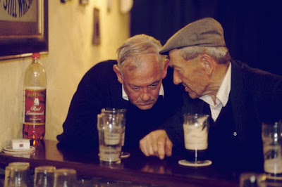 Two old men at the bar
