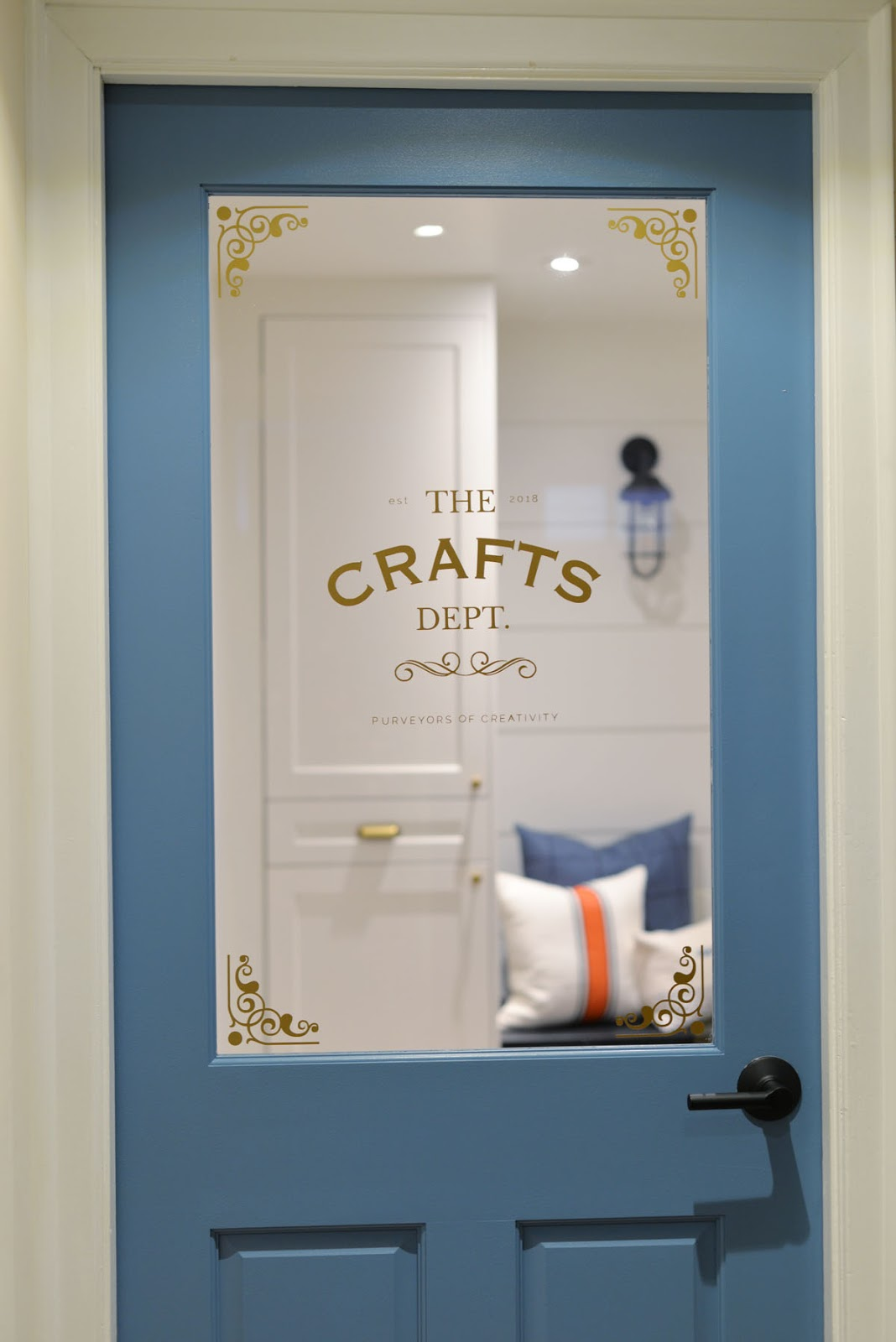 craft room door | behr blue moon bay | door decal