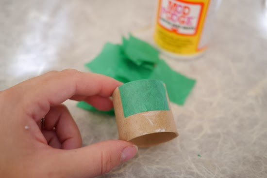 Learn how to turn a paper towel tube into a napkin holder in this fun and super easy craft tutorial for kids!
