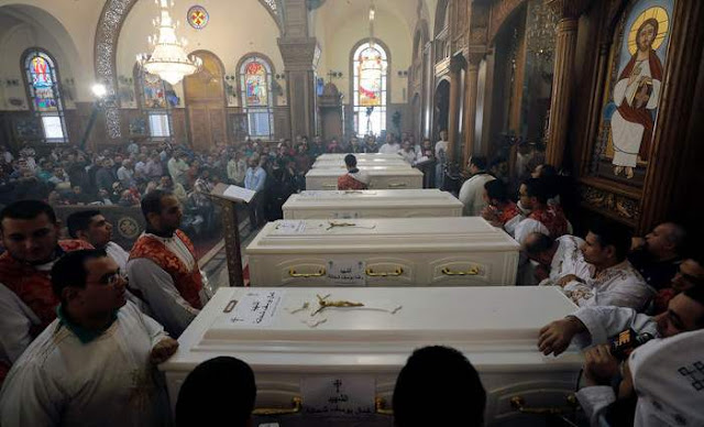 White coffins containing the bodies of the Christians killed in Egypt by Militants