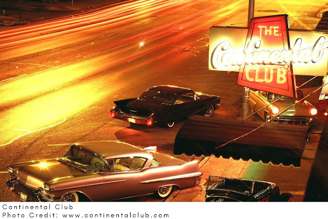classic cars parked on the street outside The Continental Club