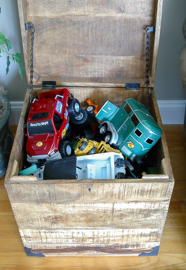 Hiding toy clutter with large hinged crates